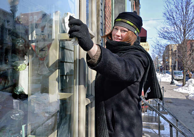 Jewelry designer Elissa Halloran struggles against the cold to wash the windows of her Lark Street shop Friday Feb. 20, 2015 in Albany, NY.  (John Carl D'Annibale / Times Union) Photo: John Carl D'Annibale, Albany Times Union / 00030704A