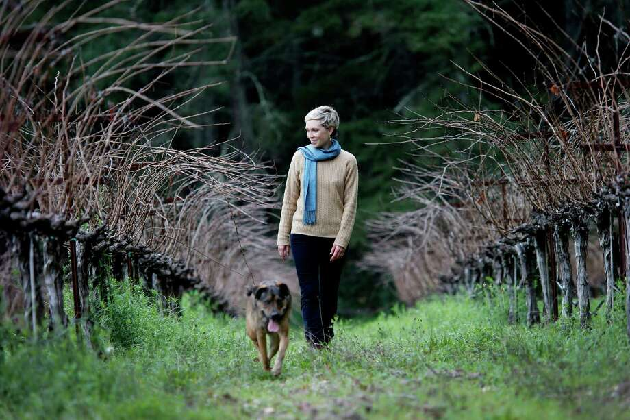 Diana Snowden Seysses, in her family's Lost Orchard parcel near Rutherford, splits her time between making Cabernet in Napa and making Burgundy in France. Photo: Brant Ward / The Chronicle / ONLINE_YES
