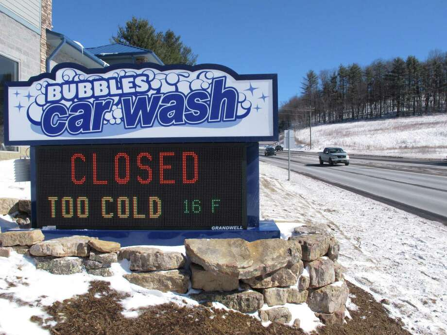 A car wash is closed due to weather conditions in Boone, N.C., on  Friday, Feb. 20, 2015. Temperatures across the South and much of the country are hitting record lows. (AP Photo/Allen G. Breed) Photo: Allen Breed, STF / AP