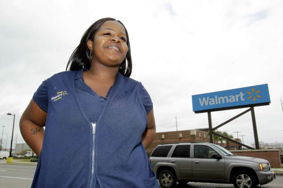 "Wal-Mart employee Malika Hall says of the raise, ""Maybe this means I won't have to live paycheck to paycheck."" Photo: Melissa Phillip, Staff / © 2014  Houston Chronicle"