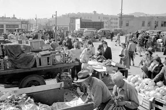 March 18, 1944: A crowd gathers around farmers with trucks full of produce at the San Francisco Farmers' Market at Market and Duboce Avenue.  The market started less than a year earlier in August 1943.
