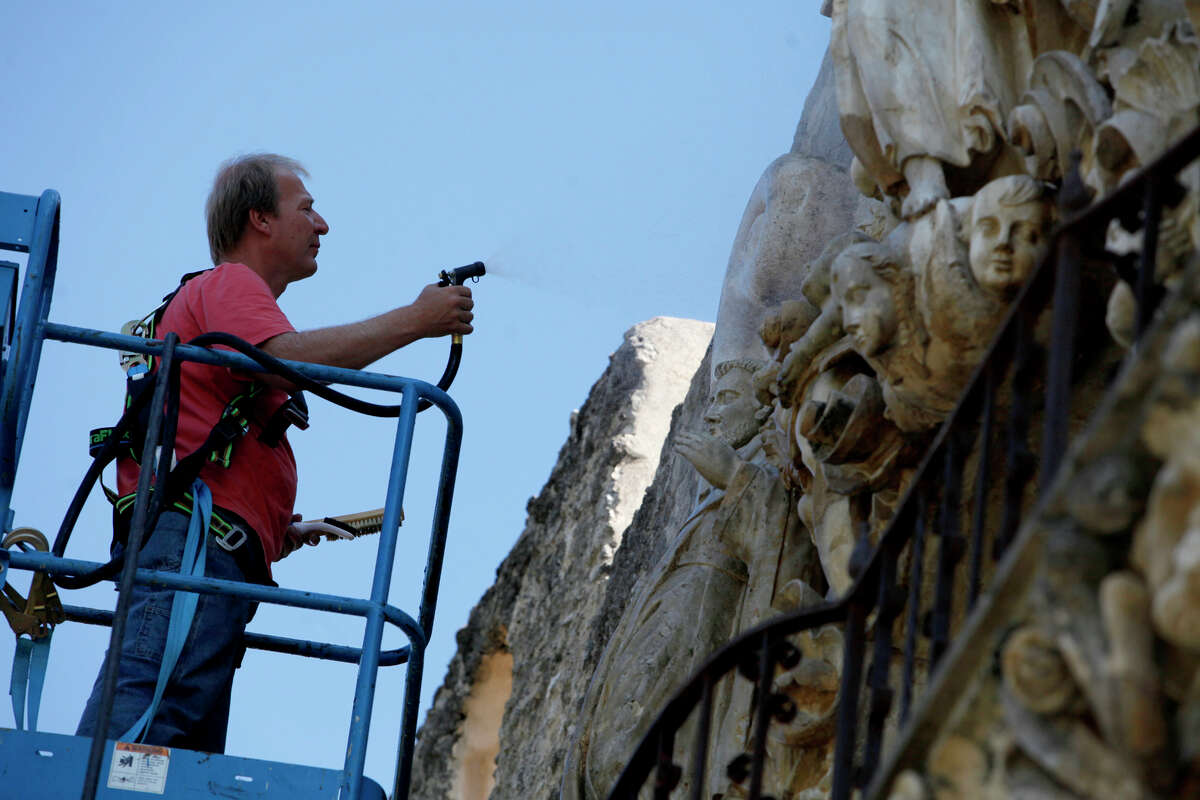 Ivan Myjer is shown in 2009 cleaning the facade of the church at Mission San Jose in San Antonio. Myjer will be working on the Alamo next.