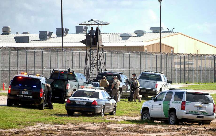 Law enforcement officials from a wide variety of agencies converge on the Willacy County Correctional Center in Raymondville, Texas on Friday, Feb. 20, 2015 in response to a prisoner uprising at the private immigration detention center. A statement from prison owner Management and Training Corp. said several inmates refused to participate in regular work duties early Friday. Inmates told center officials of their dissatisfaction with medical services. (AP Photo/Valley Morning Star, David Pike) Photo: David Pike, Associated Press / Valley Morning Star