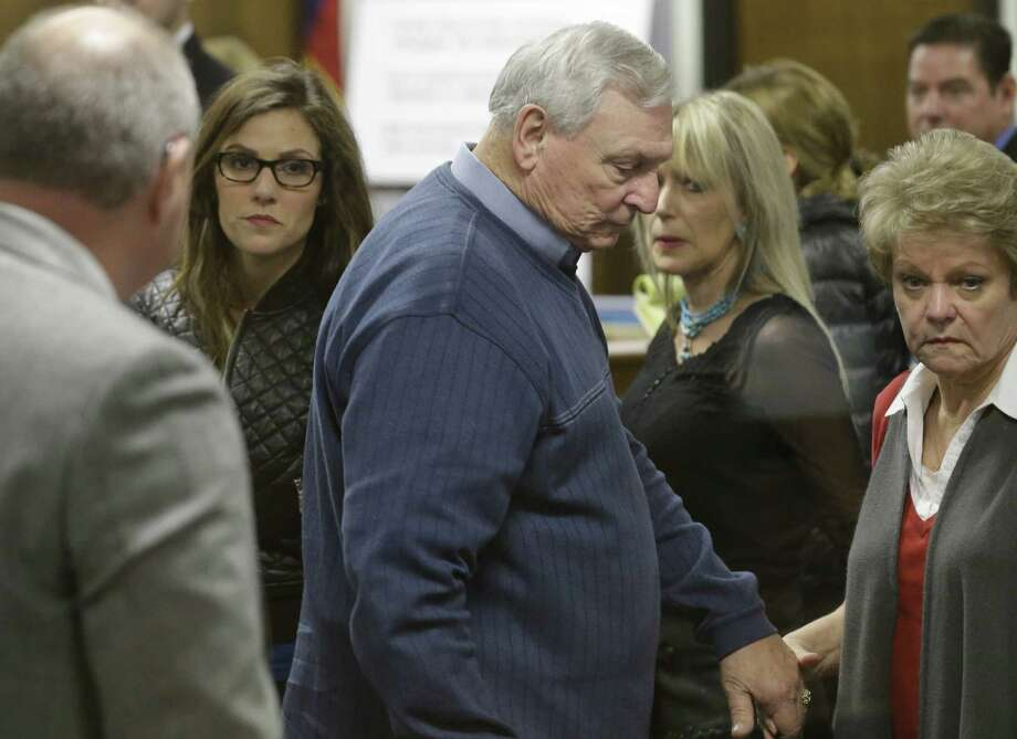 Former Navy SEAL Chris Kyle's widow, Taya, left, follows Don and Judy Littlefield, parents of Chad Littlefield, out of the courtroom after a break in the capital murder trial of Eddie Ray Routh on Friday in Stephenville. Routh is charged in the 2013 deaths of Kyle and Littlefield at a shooting range near Glen Rose. Photo: LM Otero, POOL / POOL AP