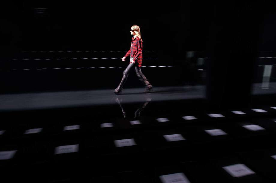 A model rehearses before the launch of a clothing line by Porsche Design during New York Fashion Week, Feb. 15, 2015. Several luxury automakers have been expanding the lines of goods they sell that have little to do with cars, brand extensions by luxury automakers help retain customer loyalty between car purchases. (Bryan Thomas/The New York Times) Photo: BRYAN THOMAS / New York Times / NYTNS