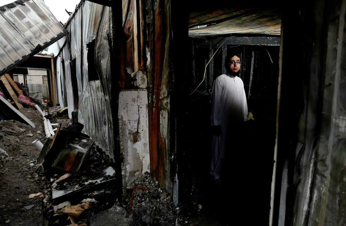 """Ahsan Zahid, assistant imam at Quba Islamic Institute, hopes charges against the homeless man accused of setting fire to this building at the religious center will be dropped. """"We always preach forgiveness,"""" he said."""