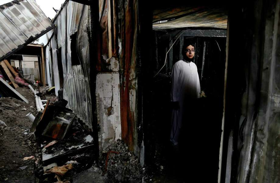 "Ahsan Zahid, assistant imam at Quba Islamic Institute, hopes charges against the homeless man accused of setting fire to this building at the religious center will be dropped. ""We always preach forgiveness,"" he said. Photo: Gary Coronado, Staff / © 2015 Houston Chronicle"