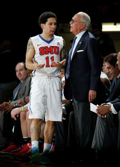 SMU point guard Nic Moore (11) and coach Larry Brown can breathe easier this season, as they're all but assured to earn a bid to the NCAA Tournament. Photo: Jim Cowsert, FRE / FR170531 AP