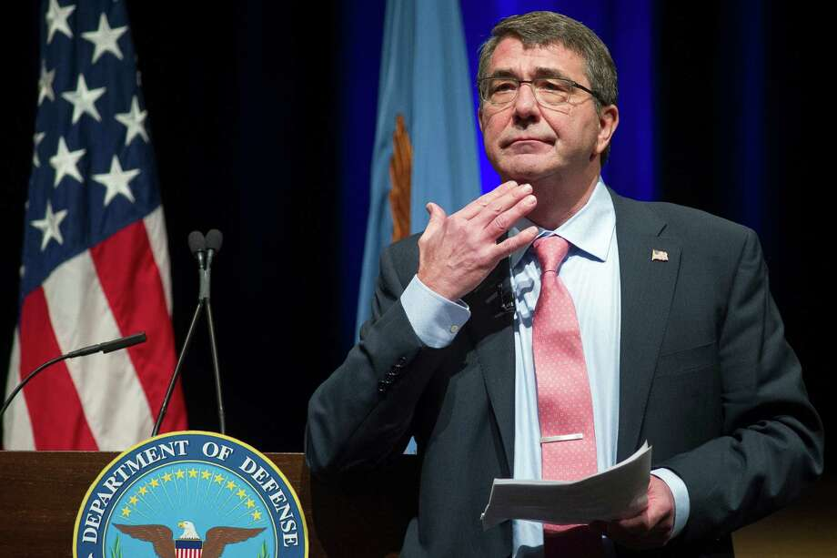 Defense Secretary Ash Carter speaks in the Pentagon auditorium, Thursday, Feb. 19, 2015, to address staff at an all hands meeting. Carter was sworn in Tuesday, replacing Chuck Hagel. (AP Photo/Cliff Owen) Photo: Cliff Owen, FRE / FR170079 AP