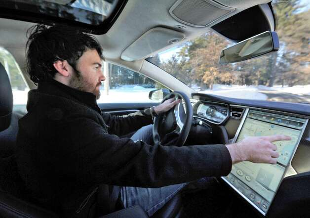 Tesla owner advisor Patrick  Moriarty drives a new Tesla Model S P85D through Saratoga Spa State Park Friday, Feb. 20, 2015, in Saratoga Springs, NY.  (John Carl D'Annibale / Times Union) Photo: John Carl D'Annibale / 00030693A