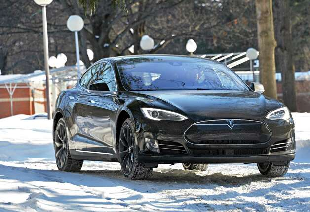 Tesla owner advisor Patrick  Moriarty demonstrates a new Tesla Model S P85D's all-wheel drive over the frozen grounds of SPAC at Saratoga Spa State Park Friday, Feb. 20, 2015, in Saratoga Springs, NY.  (John Carl D'Annibale / Times Union) Photo: John Carl D'Annibale / 00030693A