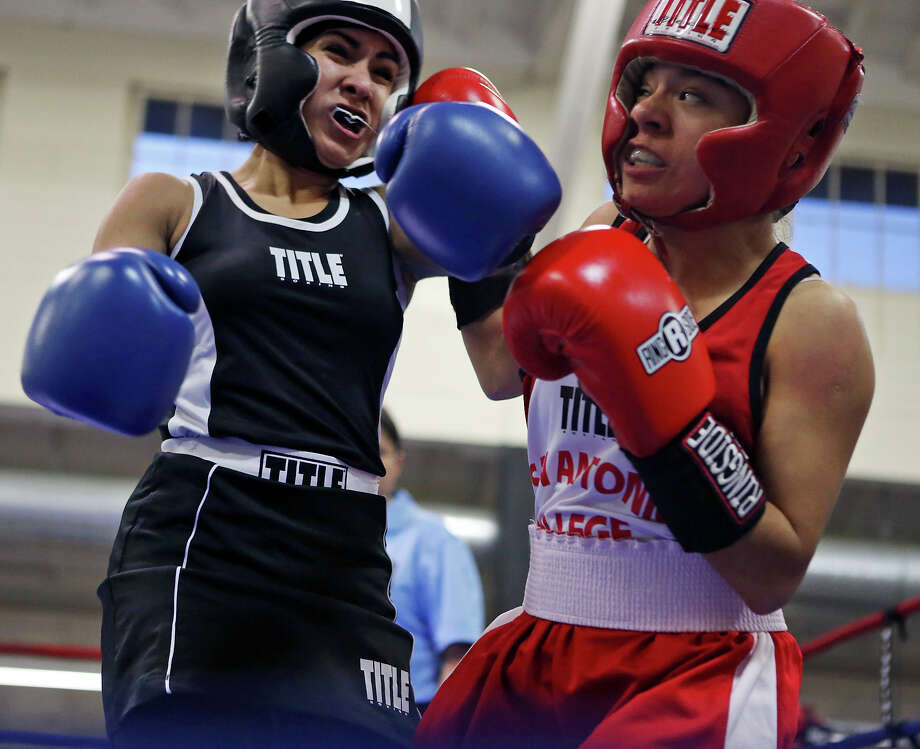 Lynzee Villafranca (left) and Maria Giron exchange punches during their female novice light flyweight championship bout part of the semifinals of the 2015 San Antonio Regional Golden Gloves boxing tournament Friday Feb. 20, 2015 at Woodlawn Gym. Villafranca won by a unanimous decision. Photo: Edward A. Ornelas, Staff / San Antonio Express-News / © 2015 San Antonio Express-News