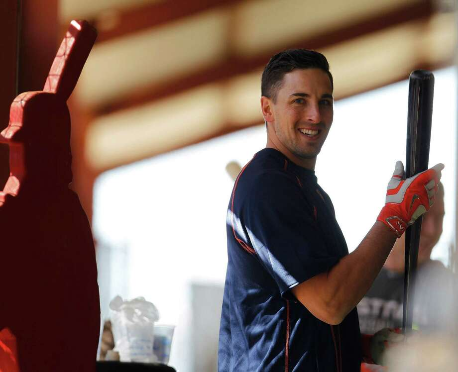 Astros catcher Jason Castro is all smiles as he gets some early work in the batting cage Friday, the first day of the club's training camp. Photo: Karen Warren, Staff / © 2015 Houston Chronicle