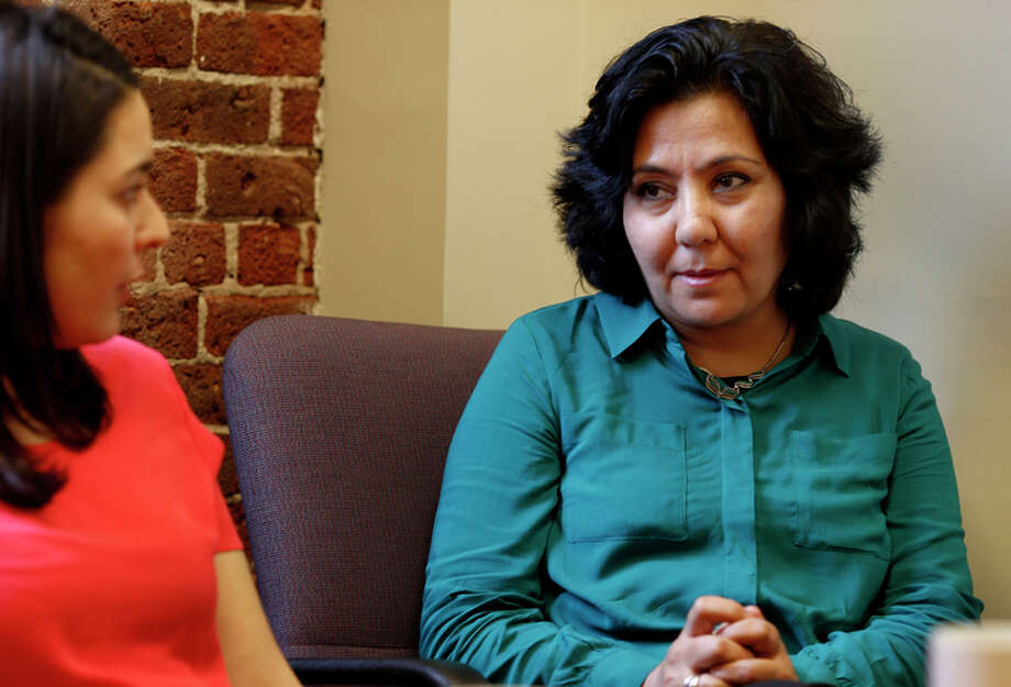 Fauzia Din (right) and translator Layma Ahmadzai discuss the case heading to the Supreme Court. Photo: Brant Ward / The Chronicle / ONLINE_YES
