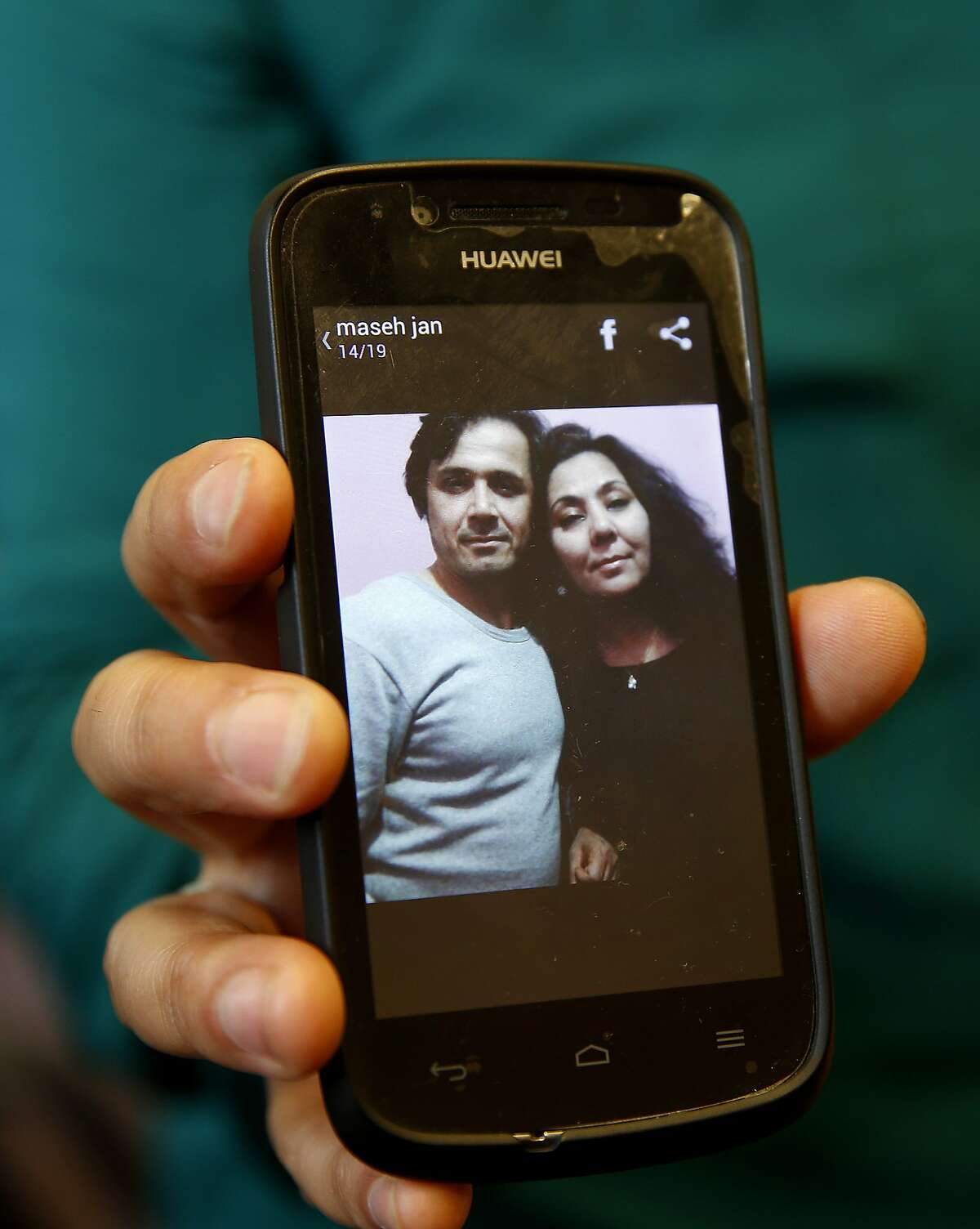 Fauzia Din holds a recent picture of her and her husband Kanishka on her smart phone Tuesday February 17, 2015 in San Francisco, Calif. Fauzia Din, a Fremont, Calif. resident, is scheduled to go before the U.S. Supreme Court soon. She wants the government to state the reason it denied a visa to her husband, who is in Afghanistan. The government says the reason was terrorism related, she says he wouldn't hurt a fly.