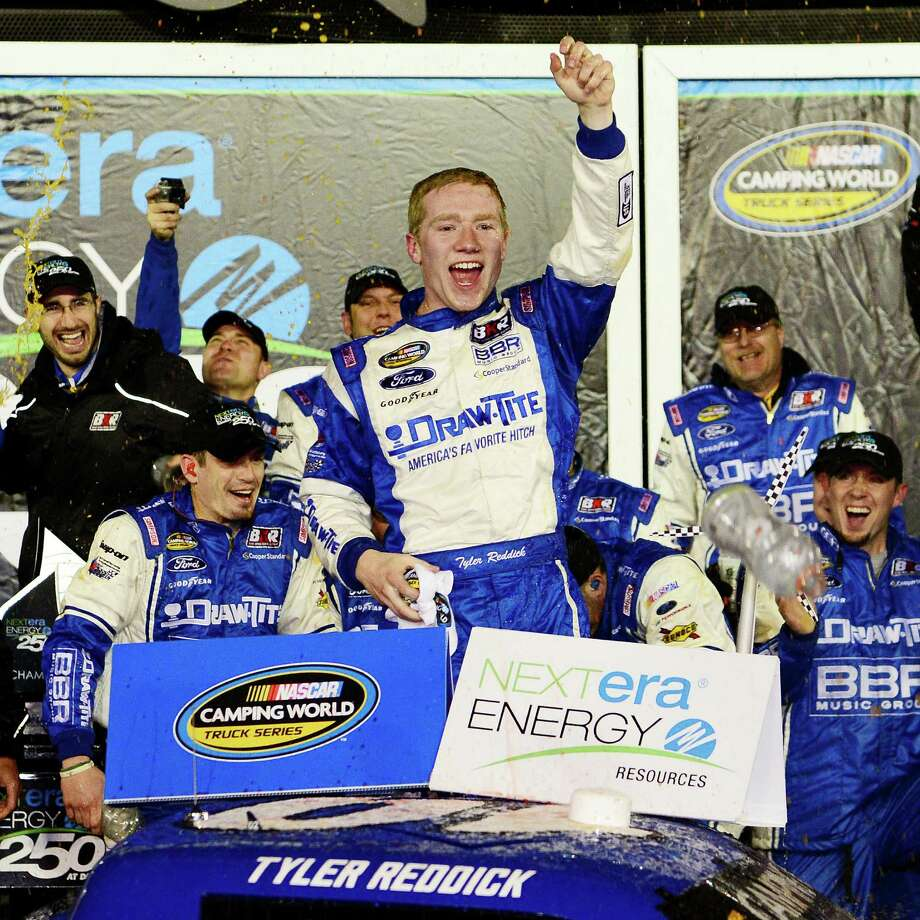 Tyler Reddick, driver of the No. 19 DrawTite Ford, celebrates after winning the NASCAR Camping World Truck Series opener Friday at Daytona. Photo: Robert Laberge, Stringer / 2015 Getty Images