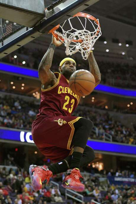 LeBron James jams one home during the Cavaliers' 38-point rout of the Wizards on Friday night. James poured in 28 points in 25 minutes of court time. Photo: Nick Wass, FRE / FR67404 AP