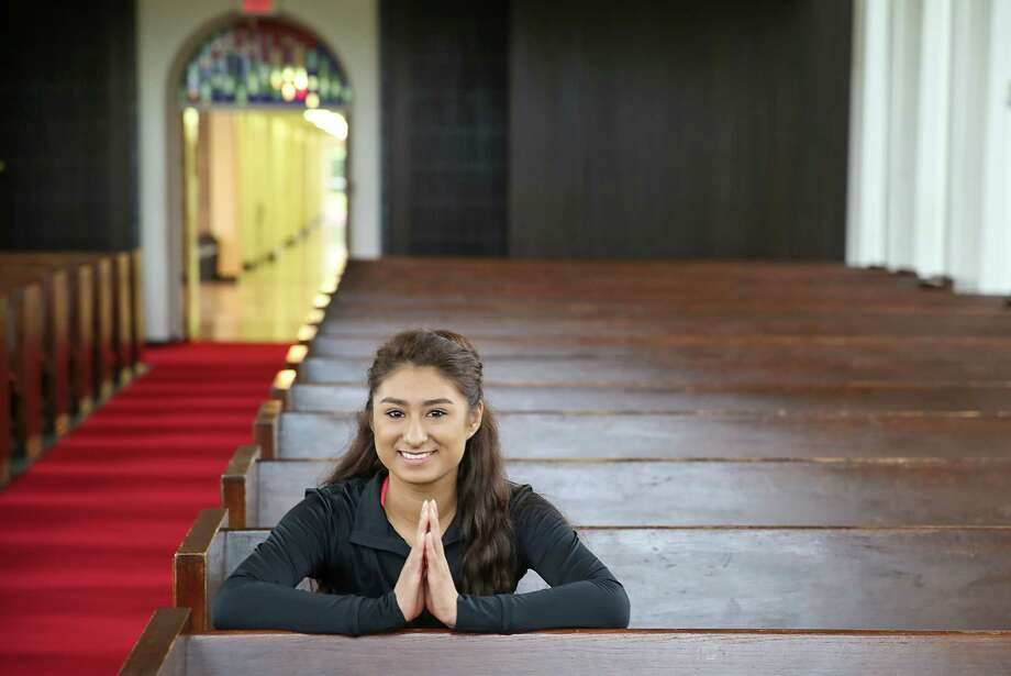 University of Houston's Bruce Religion Center brings back memories for freshman Karina Luna of practicing her Catholic religion before she got so busy with college. Photo: Thomas B. Shea, Freelance / © 2014 Thomas B. Shea