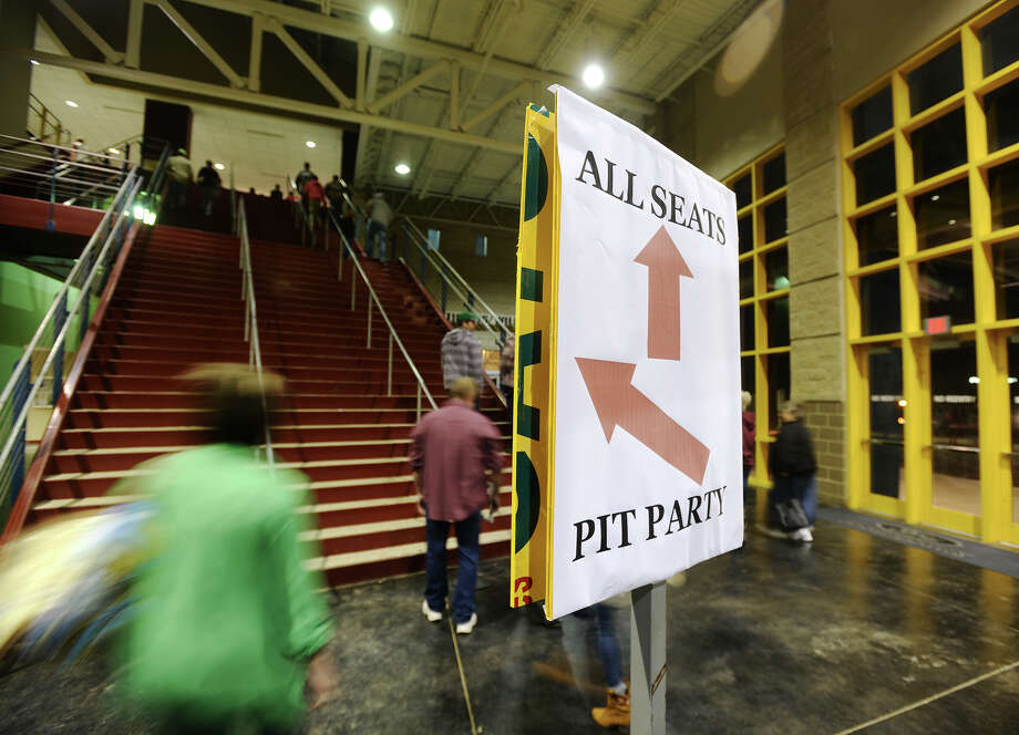 "Monster truck fans head for their seats Friday night. Monster Nation returns to Ford Arena this weekend to celebrate the 40th anniversary of the legendary Bigfoot, which is listed in the Guinness Book of World Records as the ""World's Tallest, Widest, and Heaviest Monster Truck."" Photo taken Friday 2/20/15 Jake Daniels/The Enterprise Photo: Jake Daniels / ©2014 The Beaumont Enterprise/Jake Daniels"