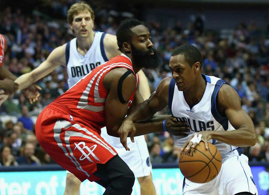 Mavericks guard Rajon Rondo, right, finds his way around James Harden at American Airlines Center on Friday night. Rondo gave the Mavs a second-half spark. Photo: Ronald Martinez, Staff / 2015 Getty Images