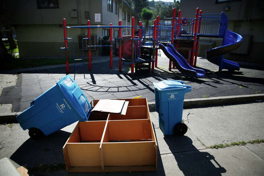 The discarded shelving next to an empty play structure is just part of Alemany public housing's disrepair. Photo: Lea Suzuki / The Chronicle / ONLINE_YES