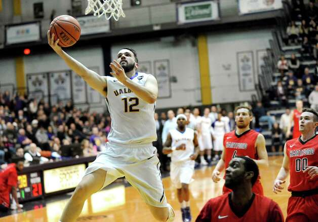UAlbany's Peter Hooley, center, shoots for the hoop during their basketball game against Hartford on Friday, Feb. 20, 2015, at SEFCU Arena in Albany, N.Y. (Cindy Schultz / Times Union) Photo: Cindy Schultz / 00030640A