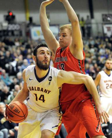 UAlbany's Sam Rowley, left, looks to the hoop as Hartford's Nate Sikma defends during their basketball game against Hartford on Friday, Feb. 20, 2015, at SEFCU Arena in Albany, N.Y. (Cindy Schultz / Times Union) Photo: Cindy Schultz / 00030640A