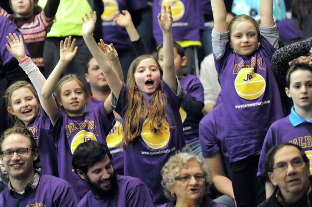 UAlbany fans scream for free T-shirts during a break in their basketball game against Hartford on Friday, Feb. 20, 2015, at SEFCU Arena in Albany, N.Y. (Cindy Schultz / Times Union) Photo: Cindy Schultz / 00030640A