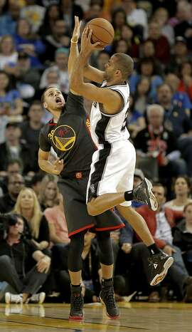 Warriors' Stephen Curry, 30 posts up against the Spurs' Tony Parker, 9 but was called for a foul which he disputed and then was called for  a technical, as the Golden State Warriors take on the San Antonio Spurs in NBA action at Oracle Arena in Oakland, Calif. on Fri. Feb. 20, 2015.