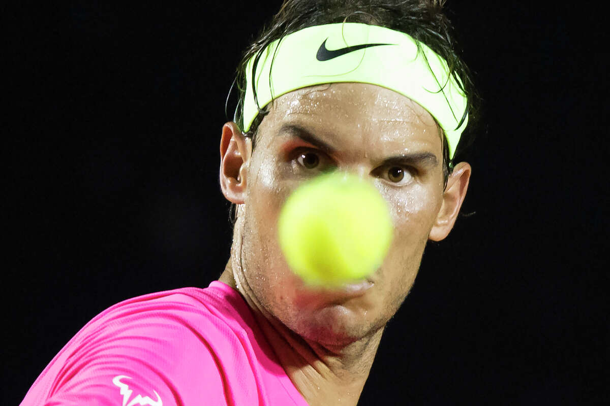 Rafael Nadal, of Spain, eyes a ball at the quarter-finals match of the Rio Open tennis tournament against Pablo Cuevas of Uruguay in Rio de Janeiro, Brazil, early Saturday, Feb. 21, 2015.