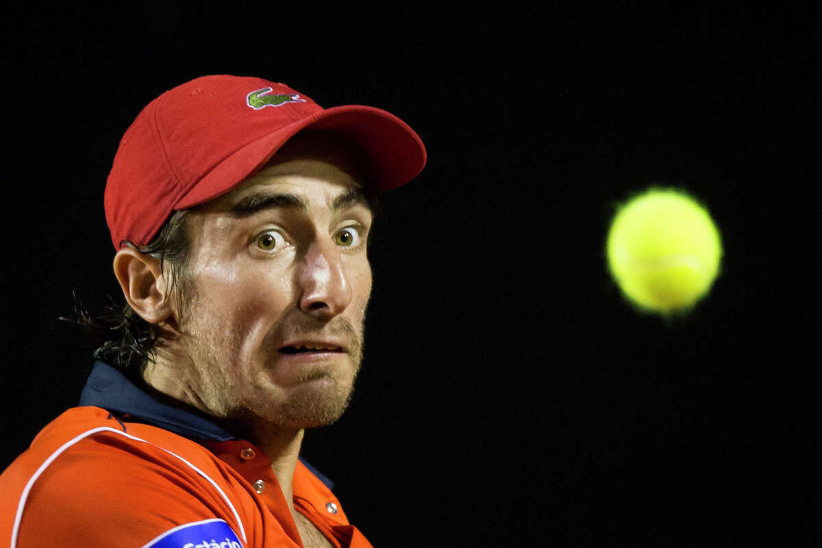 Pablo Cuevas of Uruguay, returns the ball to Rafael Nadal of Spain at the quarter-finals of the Rio Open tennis tournament in Rio de Janeiro, Brazil, early Saturday, Feb. 21, 2015.