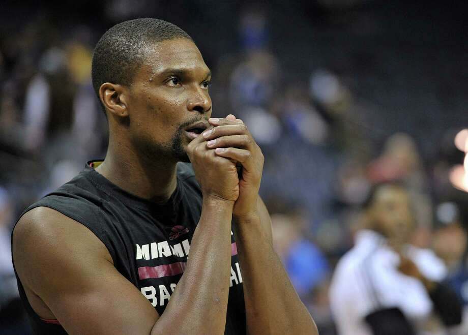 Heat center Chris Bosh, warming up before a game in Memphis in December, underwent further tests at South Florida hospital on Friday to assess a medical issue related to the area around his lungs. Photo: Brandon Dill / Associated Press / FR171250 AP
