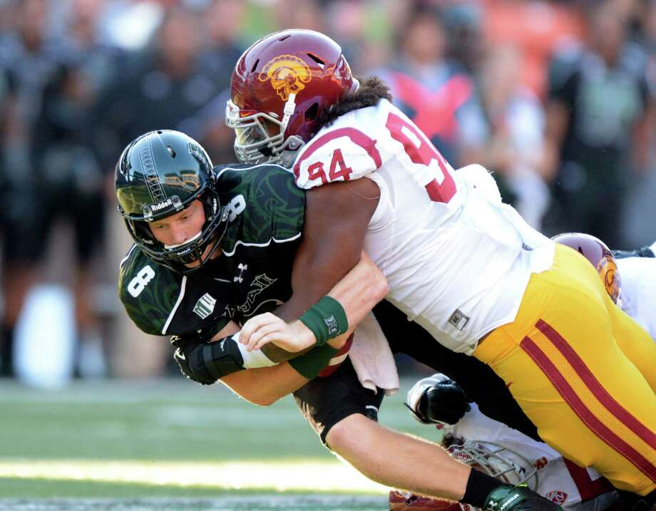 USC's Leonard Williams is expected to be a top 10 pick in the NFL Draft. Among the teams taking a good look at the 6-foot-5, 300-pound defensive lineman are the Raiders, who have the No. 4 pick in the first round. Photo: USC Athletics / USC Athletics / Kirby Lee