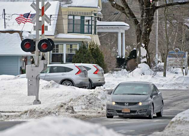 A busy railroad crossing at Voorheesville Avenue Thursday Feb. 19, 2015, in Voorheesville, NY.  (John Carl D'Annibale / Times Union) Photo: John Carl D'Annibale / 00030680A