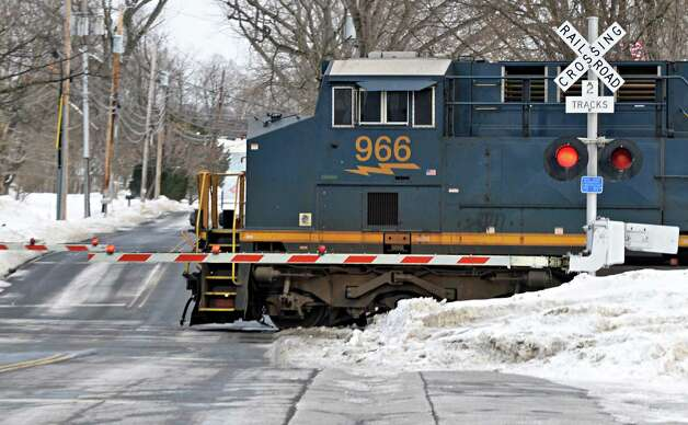 A freight train crosses the busy railroad crossing at Voorheesville Avenue Thursday Feb. 19, 2015, in Voorheesville, NY.  (John Carl D'Annibale / Times Union) Photo: John Carl D'Annibale / 00030680A