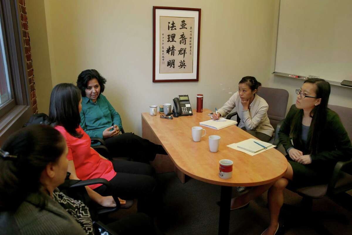 Friends and a legal team for Fauzia Din (third from left) met at the Asian Law Caucus offices Tuesday February 17, 2015 in San Francisco, Calif. Fauzia Din, a Fremont, Calif. resident, is scheduled to go before the U.S. Supreme Court soon. She wants the government to state the reason it denied a visa to her husband, who is in Afghanistan. The government says the reason was terrorism related, she says he wouldn't hurt a fly.