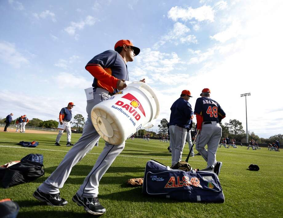 Houston Astros bullpen assistant Carlos Munoz runs with a bucket of balls during the first day of spring training workouts for pitchers and catchers at their Osceola County training facility, Saturday, Feb. 21, 2015, in Kissimmee. ( Karen Warren / Houston Chronicle  ) Photo: Karen Warren, Houston Chronicle