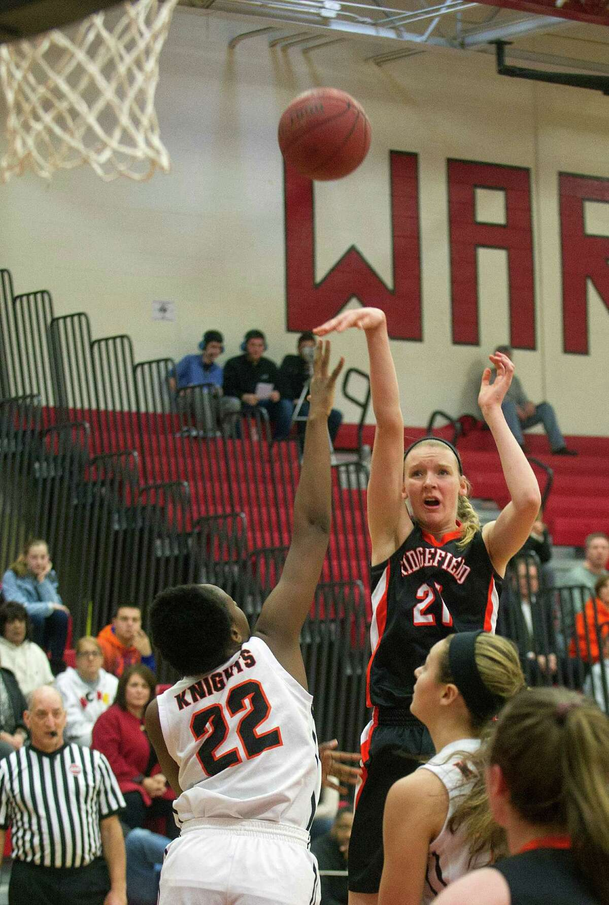 Ridgefield's Rebecca Lawrence takes a shot against Stamford during Saturday's FCIAC quarterfinal game at Fairfield Warde High School on February 21, 2015.