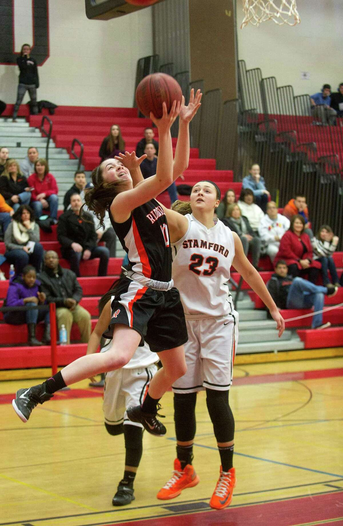 Ridgefield's Meaghan O'Hara takes a shot against Stamford during Saturday's FCIAC quarterfinal game at Fairfield Warde High School on February 21, 2015.