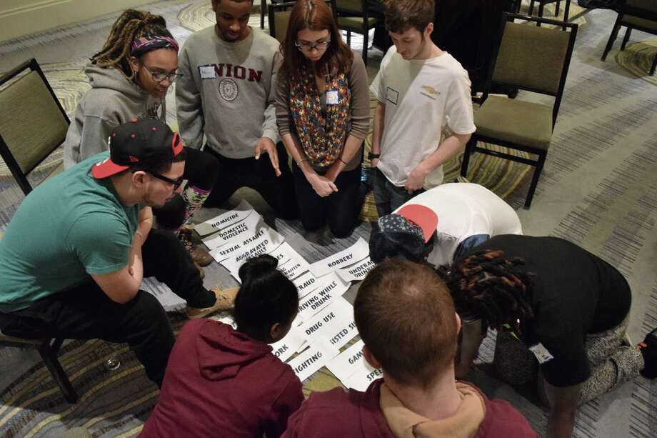 Union College students rank how they believe specific crimes should be valued in society at a PossePlus Retreat on Saturday, Feb. 21, 2015 in downtown Albany. (Brittany Horn/Times Union)
