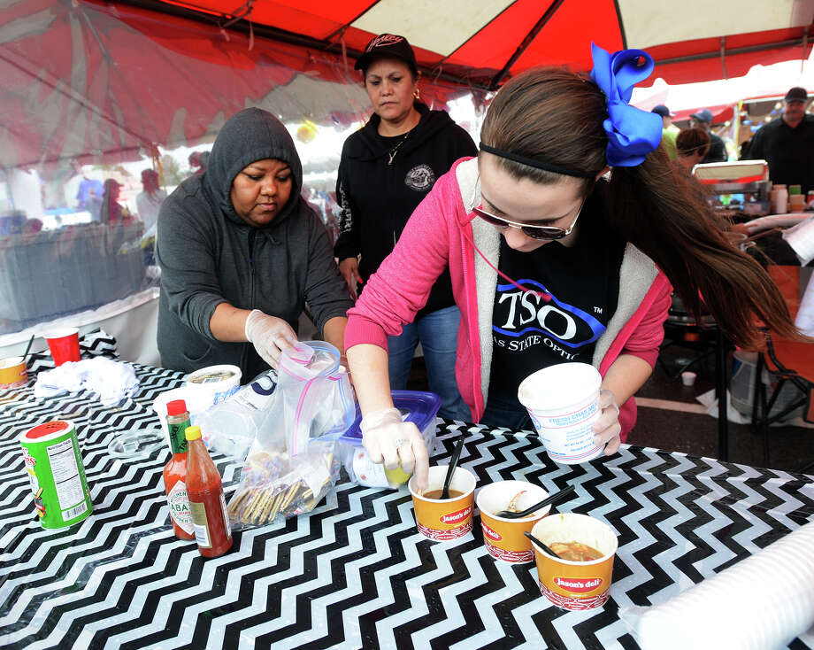 Sylvia Edwards, Susann Walker, and Trista Maxey, left to right, serve up some gumbo at the TSO table Saturday afternoon. The Girls' Haven Gumbo Festival was held in the Parkdale Mall parking lot on Saturday. The cook off attracted more than 20 teams competing with several different gumbo entries. The annual event is one of Girls' Haven's three major fundraisers, and help support the 21 girls under the group's care. Executive Director Alice Teeler said the cost of care for one girl is between $25,000 and $30,000 per year. Photo taken Saturday 2/21/15 Jake Daniels/The Enterprise Photo: Jake Daniels / ©2014 The Beaumont Enterprise/Jake Daniels