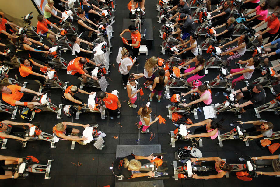 Participants spin together during the Cycle for Survival at the Equinox gym in S.F. Photo: Mathew Sumner / Special To The Chronicle / ONLINE_YES