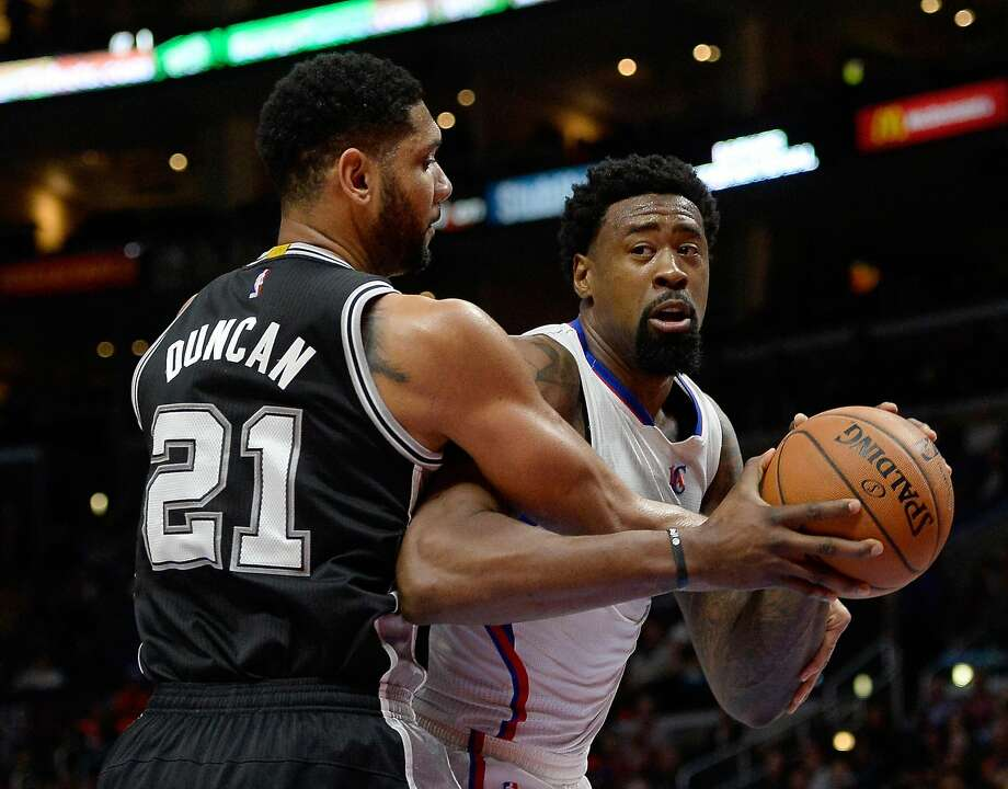 LOS ANGELES, CA - FEBRUARY 19:  DeAndre Jordan #6 of the Los Angeles Clippers is fouled by Tim Duncan #21 of the San Antonio Spurs at Staples Center on February 19, 2015 in Los Angeles, California.  NOTE TO USER: User expressly acknowledges and agrees that, by downloading and or using this Photograph, user is consenting to the terms and condition of the Getty Images License Agreement.  (Photo by Harry How/Getty Images) Photo: Harry How, Getty Images