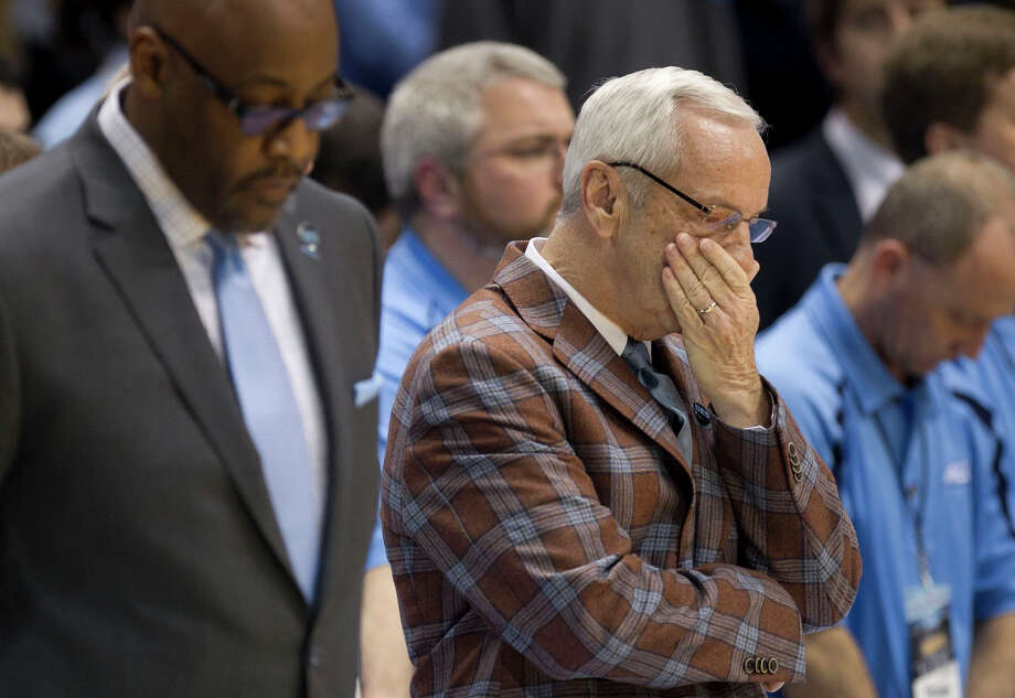 North Carolina coach Roy Williams gathers himself during a tribute to Dean Smith prior to the Tar Heels' game against Georgia Tech at the Smith Center in Chapel Hill, N.C. Photo: Robert Willett / McClatchy-Tribune News Service / Raleigh News & Observer