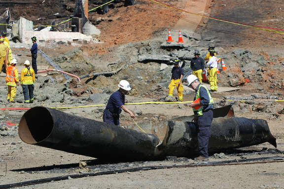 Investigators inspect a damaged PG&E pipeline in September 2010 after an explosion killed eight people and destroyed dozens of homes in San Bruno's Crestmoor neighborhood.