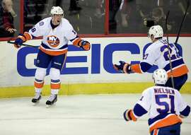 Islanders center Ryan Strome (left) celebrates his goal with Anders Lee (27), and Frans Nielsen (51) during the third period against the Capitals in Washington.