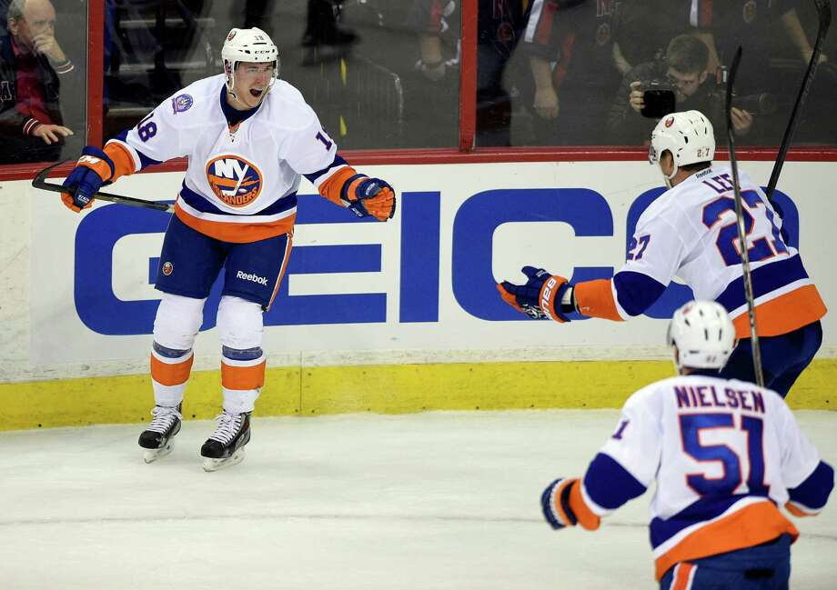 Islanders center Ryan Strome (left) celebrates his goal with Anders Lee (27), and Frans Nielsen (51) during the third period against the Capitals in Washington. Photo: Nick Wass / Associated Press / FR67404 AP