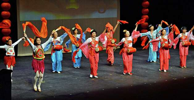The Chinese Cultural Dance Troupe performs during the NYS Capital Region 2015 Chinese New Year Celebration in the  Performing Arts Center at SUNY Albany Campus Saturday Feb. 21, 2015, in Albany, NY.  (John Carl D'Annibale / Times Union) Photo: John Carl D'Annibale / 00030681A
