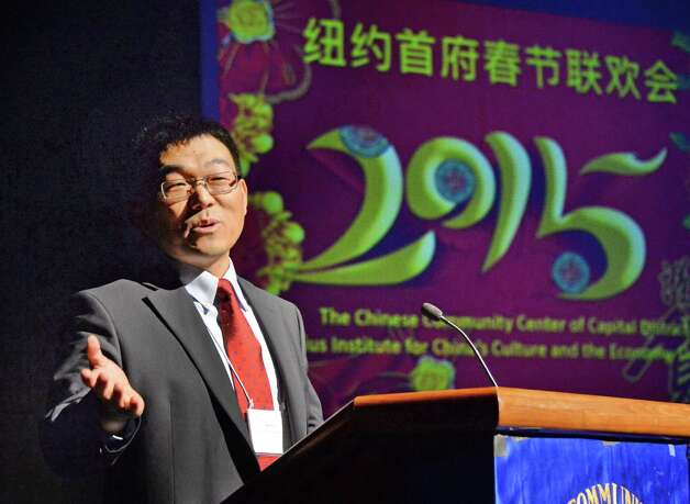 President of the Chinese Community Center Binglin Li welcomes the audience to the NYS Capital Region 2015 Chinese New Year Celebration in the Performing Arts Center at SUNY Albany Campus Saturday Feb. 21, 2015, in Albany, NY.  (John Carl D'Annibale / Times Union) Photo: John Carl D'Annibale / 00030681A