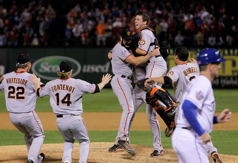 Buster Posey jumps into Brian Wilson's arms after the Giants beat the Texas Rangers 3-1 to win Game 5 and the 2010 World Series. Photo: Michael Macor / San Francisco Chronicle / SFC